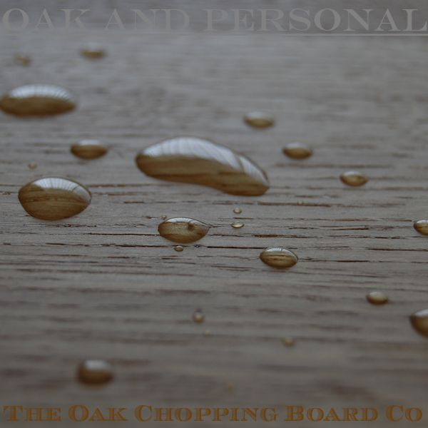 Water beads on waxed oak board