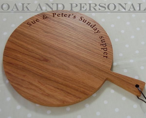 Circular wooden paddle serving board, font Byington