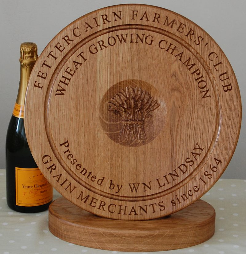 Engraved wooden chopping board trophy complete with stand