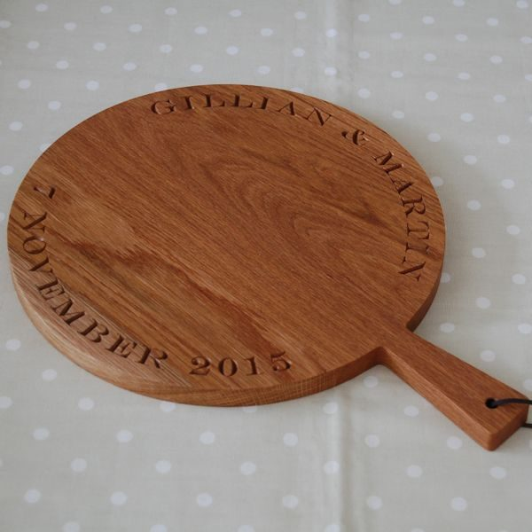 Personalised wooden paddle serving board, font Engravers MT
