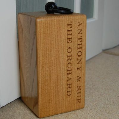 Personalised oak door stop, font Engravers MT