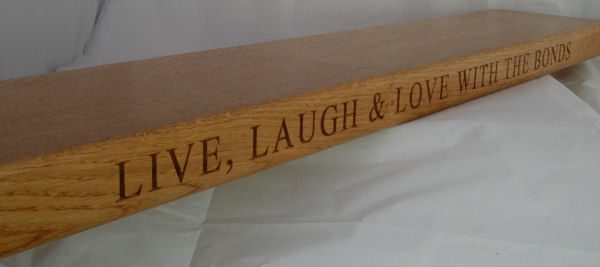Wooden engraved floating shelf, font Times New Roman