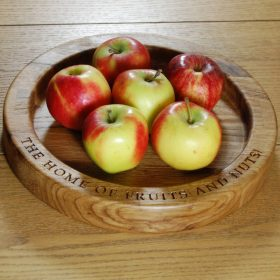 Hand crafted, engraved wooden fruit bowl, font Book Antiqua