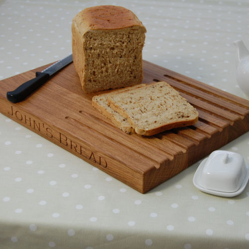 Wooden personalised rectangular bread board, size 30x40x4cm, font Copperplate Gothic Light
