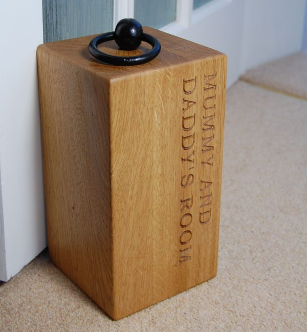 Personalised engraved wooden door stop, font Bookman Old Style