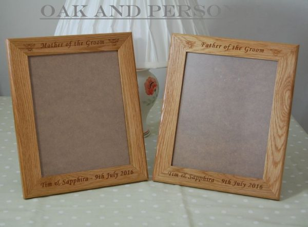 Pair of engraved photo frames for 10x8in photo, font Art Script, bumble bee motifs