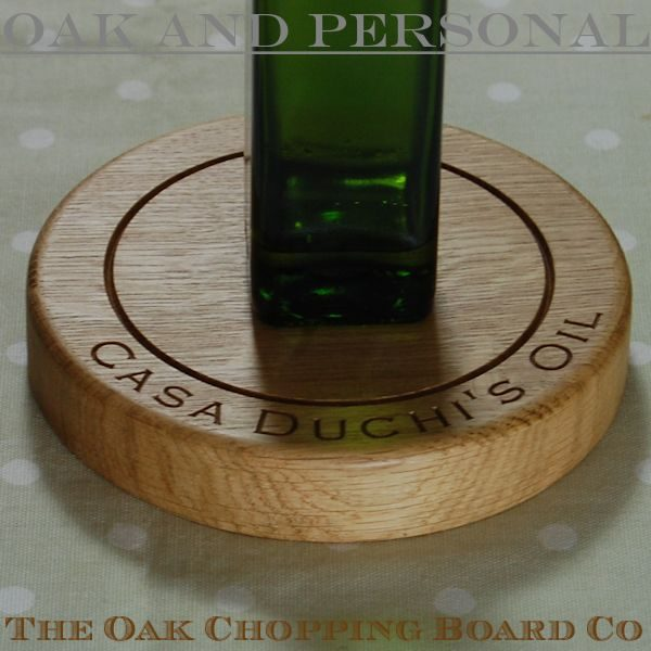 Personalised engraved wooden bottle coaster, font Copperplate Gothic Light, optional 2D olives motif