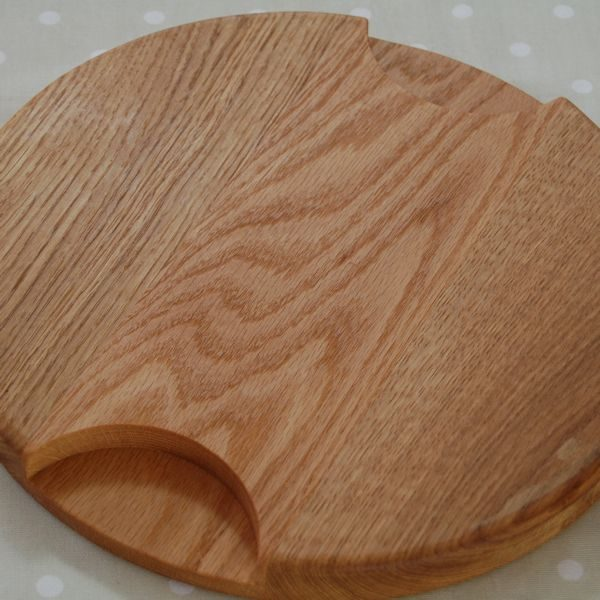 Cheese board includes two recessed handles