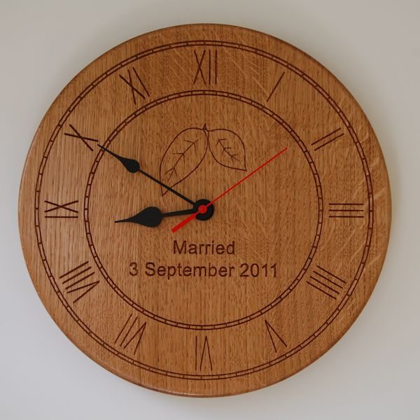 Personalised wooden wall clock, size 30cm diameter, font Arial, optional leaves 2D motif