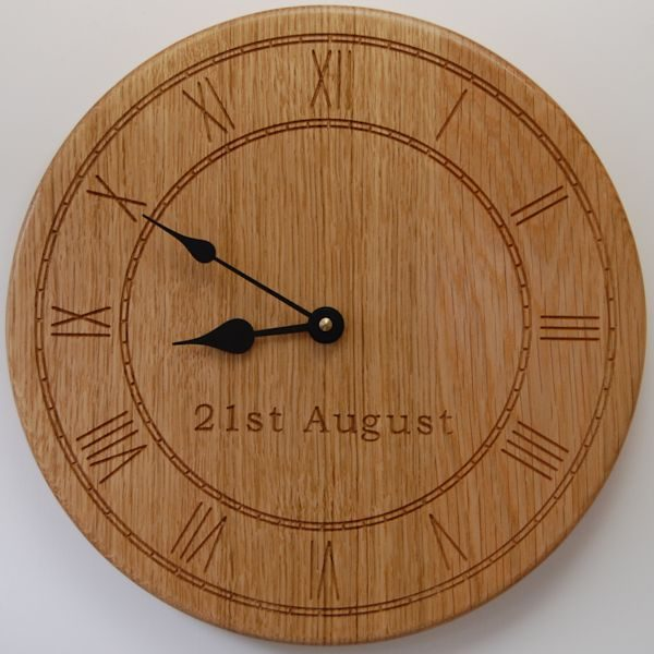 Personalised wooden wall clock, size 30cm diameter, font Bookman Old Style