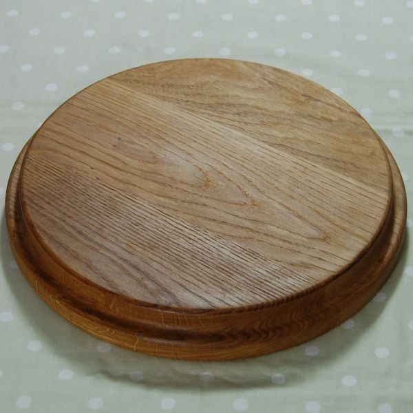 Circular wooden sink top chopping board (view of underside)